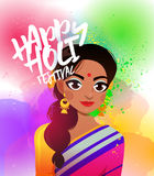 Happy Holi lettering card design with beautiful Indian woman in a sari on the background of colorful gulal. Young Indian woman in a sari on the background of Stock Photo