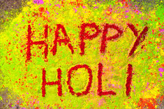 Happy holi. Written with Dry holi colours stock image