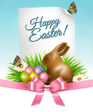 Happy Holiday background. Easter eggs and a chocolate bunny. Stock Photos