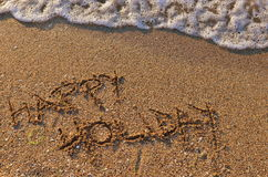 Happy holiday at the beach Stock Images