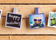 Happy Holiday with fruity friends. Happy Holiday snaps on a line of cool fruity friends, a coconut and pineapple, enjoying the tropics in their sunglasses and Stock Photo