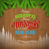 Happy holiday lettering  and lndscape silhouette on vintage wood background with fir tree Royalty Free Stock Photo