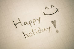 Happy holiday. Happy holiday message on paper Stock Photos
