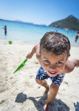 Happy Holiday Smiles. A young boy having fun at the beach whilst on holiday Stock Photo