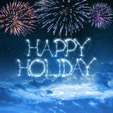 Happy Holiday written with sparkler on night sky Stock Photography