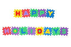 Happy Holidays. Message Happy Holidays from letter puzzle, isolated on white Stock Image