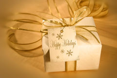 Happy holidays. Holiday gift with gift card Stock Photography