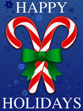 Happy Holidays. An illustration of two candy canes crossed and tied with a ribbon. Background placed on separate layer Stock Image
