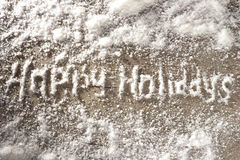 Happy Holidays. Lettering Happy Holidays. Snow letters on a wooden surface Stock Images