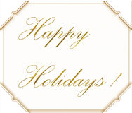 Happy Holidays. Written in gold script on white with four photo corners Royalty Free Stock Photos