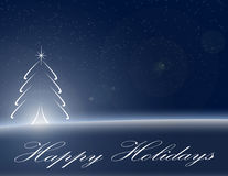 Happy Holidays Background. Blue blowing Christmas tree with elegant Happy Holidays script Royalty Free Stock Photography