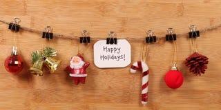 Happy holidays. Beautiful shot of happy holidays written on white chit stock image