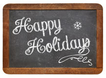 Happy Holidays on blackboard Royalty Free Stock Images
