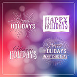 Happy Holidays Calligraphic Design Label on defocus background. Stock Photos