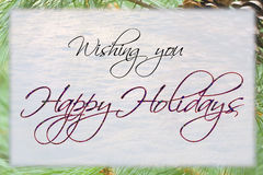 Happy Holidays Card. With snow and pine background Royalty Free Stock Image