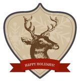 Happy Holidays - Christmas Badge. Christmas and new year greetings badge with vintage style. It reads Happy holidays and has a reindeer. The badge has snowflakes Royalty Free Stock Image