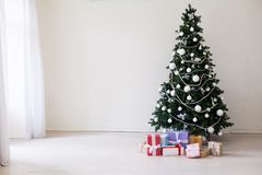 Happy holidays Christmas new year tree gifts royalty free stock image