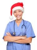 Happy holidays christmas nurse. Wearing santa hat. Asian woman model isolated on white background stock photo