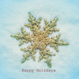 Happy holidays. A christmas star on the snow and the sentence happy holidays, with a retro effect Stock Images