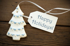 Happy Holidays on a Christmas Tree Cookie Royalty Free Stock Photos