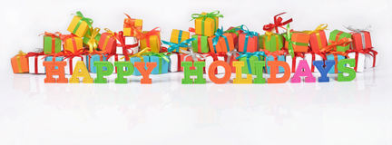 Happy holidays colorful text on the background of gifts Royalty Free Stock Photos