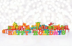 Happy holidays colorful text on the background of gifts Royalty Free Stock Photo