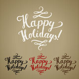 Happy holidays craft. Happy holidays lettering rubber stamp at recycled paper pack Stock Image