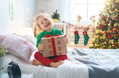 Child opening Christmas present royalty free stock images