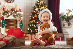 Girls opening Christmas gifts stock images