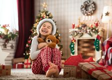 Girls opening Christmas gifts royalty free stock photos
