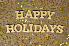 Happy holidays golden text and golden stars. On a wooden background Stock Image