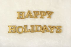 Happy holidays golden text on a white stock photos