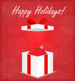 Happy Holidays Greeting Card Gift Box with Bauble Red Background Stock Photo