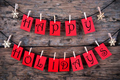 Happy Holidays Greetings on a Line Stock Image