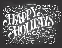 Happy holidays hand-lettering on chalkboard background Royalty Free Stock Photo