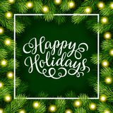 Happy Holidays hand lettering inscription with frame of fir branches Royalty Free Stock Image
