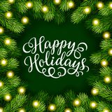Happy Holidays hand lettering inscription with frame of fir branches Stock Photos