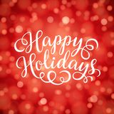Happy Holidays hand lettering inscription on red bokeh light background. Hand drawing calligraphy phrases for greeting card, poster, banner, website, header Stock Images