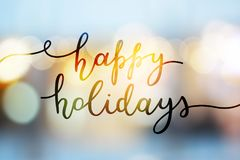 Happy holidays lettering. Happy holidays, lettering on blurred background royalty free stock images