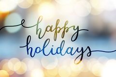 Happy holidays lettering. Happy holidays, lettering on blurred background royalty free stock image
