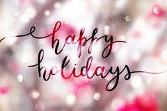 Happy holidays lettering. Happy holidays, lettering on winter blurred background Royalty Free Stock Photo
