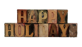 'Happy Holidays' in letterpress wood letters. The phrase 'Happy Holidays' in letterpress wood letters isolated on white Stock Photo