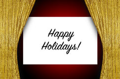 Happy holidays sign on stage. Open gold curtains on stage revealing sign happy holidays Stock Photos