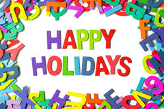 Happy holidays. Spelled out with colorful wooden blocks royalty free stock images