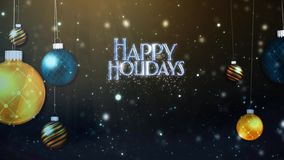Happy Holidays Swinging Ornaments Blue and Gold. This video Features swinging ornaments on a dark background with an animated sparkling swish that reveals a stock video