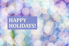 Happy holidays text on blurred background Stock Images