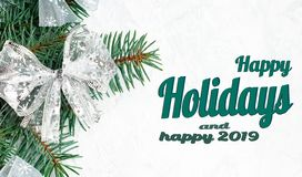 Christmas branches of a New Year tree, christmas decorations Top view, flat lay. Happy Holidays and happy 2019 text. Happy Holidays Text with Holiday Evergreen stock photo