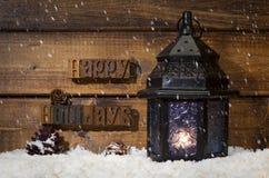 Happy Holidays Text With Burning Lantern royalty free stock photos