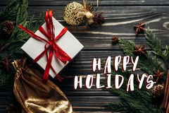 Happy holidays text sign on stylish christmas flat lay presents Royalty Free Stock Photography