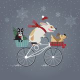 Happy Holidays. Three cute dogs on bicycle going to holiday party. Happy new year concept Stock Photography